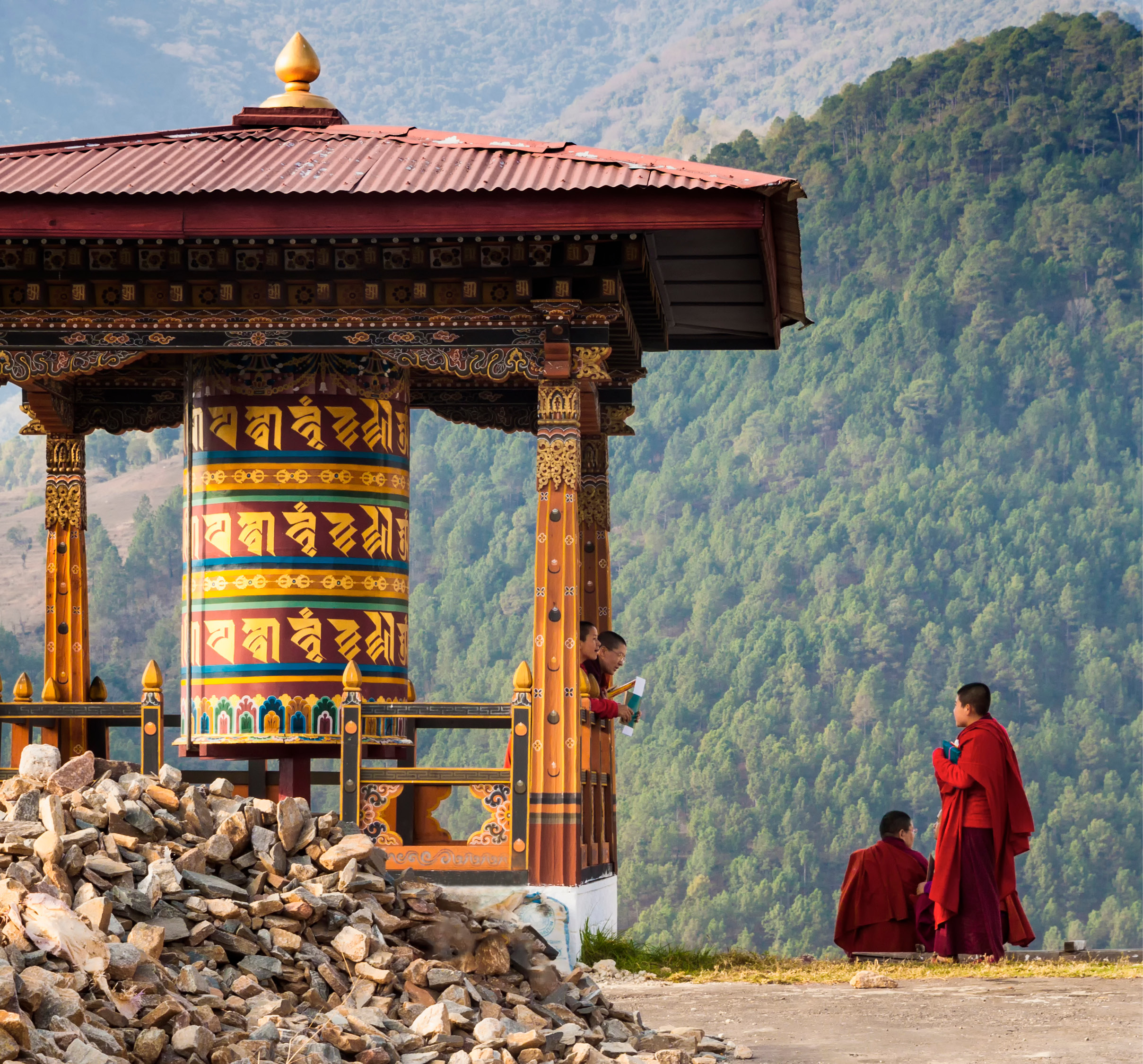 monks at a mountainside temple in the Himalayas of Bhutan